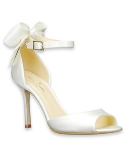 """This ivory silk pump from kate spade, theIzzie, features an opend'orsay heel that reveals the lovely arch of a foot. An ankle strap and 3 1/4"""" heel are emphasized by the signaturekate spade classic ivory bow at the heel. So pretty!"""