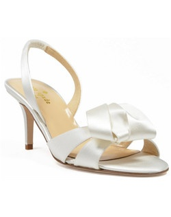 "The Madison from kate spade is an elegant slingback shoe that features a 2 1/2"" heel and a gorgeous foldover bow detail at the peep-toe. The ivory silk adds an elegant and finished look."