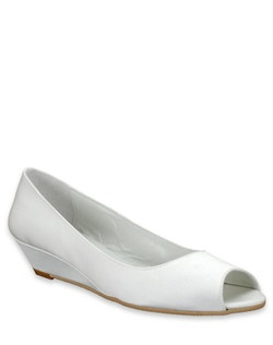 """From Something Bleu comes the Giggles shoe: a simple and practical white silk bridal shoe that features a peep-toe and a pretty wedge heel. The heel measures 1 1/2"""" offering a little lift, along with the confidence of a comfortable walk down the aisle."""