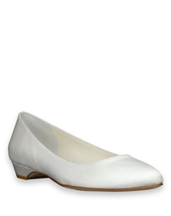 "The Scoop wedding shoe from Something Bleu is a simple white closed-toe flat with a practical 1"" heel. The white silk shoe is versatile and classic."
