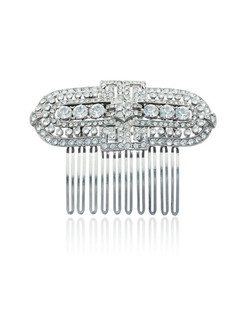"""This unique Belle Epoque-inspired crystal hair comb, designed by Ben Amun Bridal, showcases a lovely combination of small and larger round hand-cut Swarovski crystals with a scallop shaped detail. Wear it alone for a dramatic effect suited to any bridal ensemble. The comb measures 2.75"""" long."""