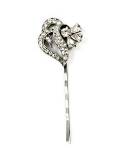 """Our """"Charlotte"""" crystal hairpin, designed by Ben Amun Bridal, features pear-shaped and round hand-cut Swarovski crystals overlap into a ribbon-shaped silver-plated setting. The overall effect is of a shimmery vintage rosebud tied with crystal ribbons. The comb measures 2.5"""" long."""