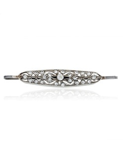 "This ""Daphne"" styled crystal hairpin, designed by Ben Amun Bridal, features a lovely oblong silver-plated pewter setting that's set with round hand-cut Swarovski crystals. One central crystal anchors the look into a symmetrical, glittering lace style. The hairpin measures 2.5"" long."