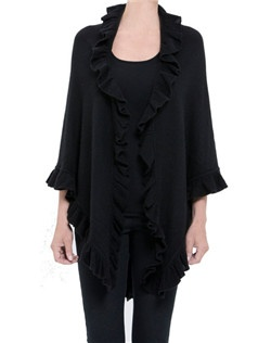 Our popular ruffle trim scarf is crafted froma lovely100% cashmere. The ruffle scarf is perfect as a travel companion as it can be easily stowed in a bag for long plane rides or chilly evening strolls. The ruffle cashmere scarf comes in black or white. One size fits all.