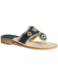 "Our Nantucket sandal in navy features our signature whipstitch trim in gold metallic. This elegant ""something blue"" pair is oh-so comfortable thanks to its rich leather construction and barely-there heel. We think you'll wear this pair from dinner and dancing straight to the honeymoon, but the choice is yours."
