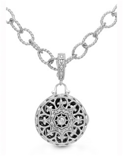 Featuring intricate curves to create a design that harkens simpler days, Beatrice fuses sterling silver and diamond pavé to create a distinctive piece that's delicate yet three dimensional, giving admirers a peek of the photo inside. The 9-inch chain is long enough to wear as an anklet and can be shortened to custom fit your wrist. Locket measures 16mm diameter.
