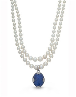 """Pay tribute to those you love with striking blue lapis. Set in sterling silver and finished with white topaz accents, this timeless piece is destined to be a treasured addition to any collection. A 16.5"""" strand of Freshwater Pearls holds the 22 x 18mm locket."""
