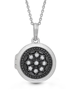 "The perfect compliment to the little black dress (or t-shirt), this versatile piece keeps those you love close to your heart. Luminous white topaz and oxidized sterling silver come together to give the illusion of black diamonds in this beautifully crafted round locket. 18"" Sterling Chain features a jump ring at 16"" allowing two length options. Locket measures 18mm."