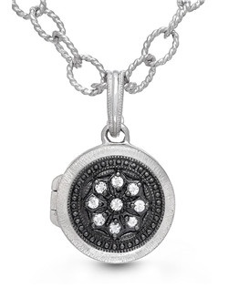 The perfect compliment to the little black dress (or t-shirt), this versatile piece keeps those you love close to your heart. Luminous white topaz and oxidized sterling silver come together to give the illusion of black diamonds in this beautifully crafted round locket. The 9-inch chain is long enough to wear as an anklet and can be shortened to custom fit your wrist.Locket measures 15mm.