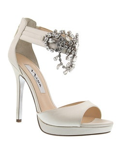 """""""Close your eyes and imagine you're dancing the night away. Wrapping your ankle in crystals, the Fabiola is your glamour sandal. This shoe makes even the simplest outfit a showstopper.  • Sandal • Back Zipper Entry  • Satin