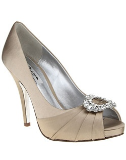 """""""Asymmetric crystals line this beautiful kitten heel pump perfect the best alternative to a high heel that will have you comfortably dancing on your feet the whole night through.  • Pump • Crystal satin   luster shine • Available in bridal basics: Ivory & champagne  • 1 1/2"""""""" Heel • Imported"""""""