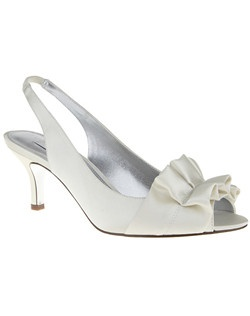 """We love the accent of a ruffle accessory on an open toe sandal. The Cyra sling back is the go-to sandal to provide the perfect amount of coverage and stability without sacrificing an ounce of fashion.
