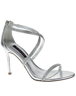 """""""This crystal strappy sandal will play a starring role in your wardrobe. Let this style shine and wear it with your favorite LBD for a signature evening look. • Sandal • Zipper closure  • Beaded/Peau ankle strap • Available in Bridal Basics ivory and silver • 4"""""""" Heel"""""""