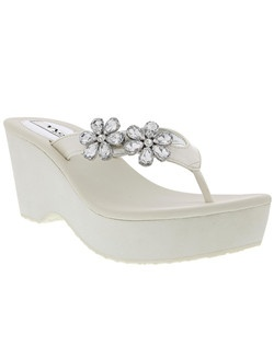 """Walk on air in our feminine Balerie floral thong sandal. For the girl who likes a little lift, this sandal will take you to the beach, to lunch or shopping with the girls and will never stop sparkling in the warm sun.    