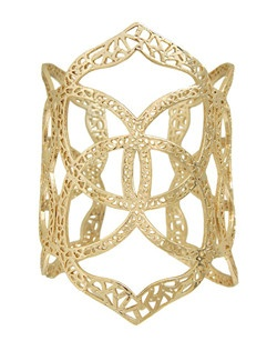 A multitude of Kendra Scott medallions form together to create an airy cuff. Easily adjustable, this piece is perfect for everyday wear!  Price includes center stone and setting