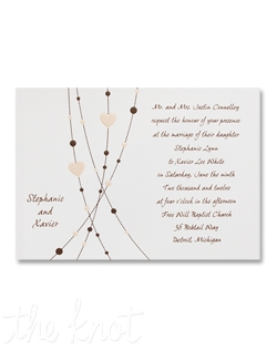 A string of Chocolate dots and Soft Pink hearts sweep across this invitation to add playful drama to this card. The couple's first names are featured on the left side of the design, while your words of invitation are on the right.