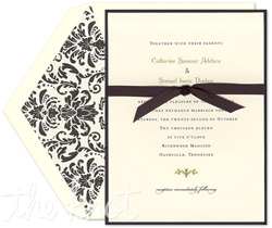 Timeless elegance collides with modern romance with this contemporary layered wedding invitation ensemble by William Arthur.  A black bottom card lies beneath a crisp white top card which is delicately wrapped with a black satin ribbon.  A nouveau floral motif lies amidst your wedding details.  Pair this floral ensemble with a coordinating nouveau black and white floral envelope liner to create a lasting impression upon your guests.