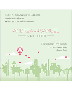 This whimsical wedding stationery suite features a beautiful city background with a hot air balloon and floating hearts.