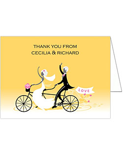 This wedding stationery suite features a beautiful design of a bride and groom riding a tandem bicycle trailing heart streamers and a LOVE sign in the back. On the front of this bicycle built for two is a lovely basket of flowers. Elegant meets adorable!