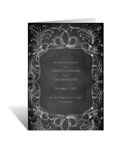 A flourish frame appears sketched around your wording on this chalkboard wedding program.