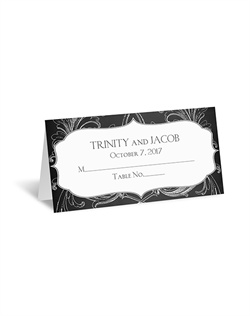 A flourish frame appears sketched around your wording on this chalkboard place card. Choose any two colors and fonts for your wording.