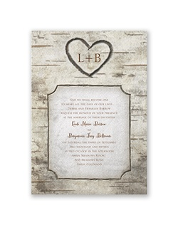 "This birch wood wedding invitation is ""carved"" with a heart around your initials and a frame around your wedding details. The heavy weight, textured invitation is printed with your wording in your choice of colors and lettering styles."