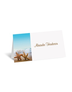 A pair of romantic starfish by the ocean sets the tone for your own beach wedding or destination wedding! Your wording appears alongside the photograph on this place card.