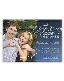 "Your love was written in the starsand now those stars have aligned to announce your wedding date on this save the date magnet. Your photo is printed along with the ""Save the Date"" design in white as shown. Your wording is printed in white in your choice of lettering styles."