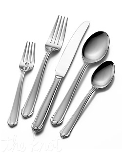 With a delicate flourish at the base of the satin-finished handles, this flatware dresses up the everyday table. Made of 18/0 stainless steel, this 65 piece set includes service for 12. Dishwasher safe.