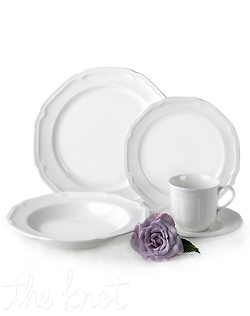 Distinctive curves, unique shapes and an elegant white glaze gives this fine china dinnerware a modern sensibility with a touch of old world charm. Dishwasher & Microwave safe.