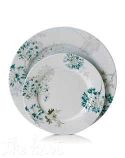 Romance blossoms at tables of Silk Floral dinnerware. Modern, fuss-free porcelain from Mikasa bears artsy garden blooms in teal and cream for a look of serene grace and femininity. Place setting shown with charger plate.