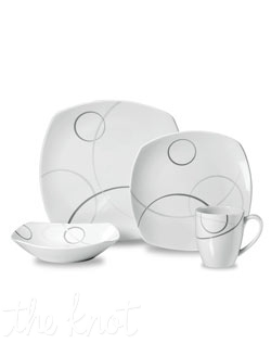 This stunning contemporary porcelain dinnerware has a unique curved design and rounded edges that are carried along by the delicate platinum geometric circle pattern on each piece. Microwave and dishwasher safe.