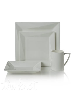 This contemporary bone china dinnerware has a modern square shape with a layered fold effect. Microwave and dishwasher safe.