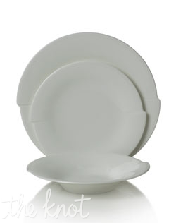 This contemporary bone china dinnerware has a unique notch on either side of each piece that gives it the effect of spinning. Microwave and dishwasher safe.