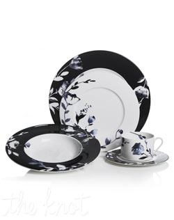 Midnight Bloom dinnerware features graceful florals adorning a sleek, flat rimmed bone china shape for a classic and timeless design.
