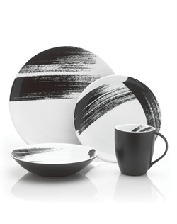 A marriage of modern art and dining, Brushstroke allows you to transform your table into a palette. Each porcelain piece is adorned with a unique brushstroke and a solid black back to create a truly distinct look on your table. Perfect for casual entertaining. Dishwasher and microwave safe.