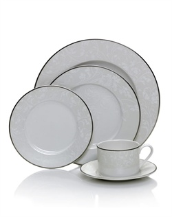 Tanglewood takes classic floral dinnerware design to a new level of sophistication for a modern table. The subtle stems do a delicate dance within a bold platinum border, creating a striking contrast. Soft white porcelain with a platinum banding.