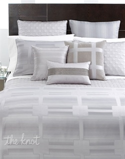A light grid pattern over a subtle, ombr¨¦ ground presents an understated, elegant design. Accents include fine beaded detailing, velvet texture, piping details and lush quilted geometry. Its luxurious comfort meets sheer sophistication in this refined design ? only from Hotel Collection.