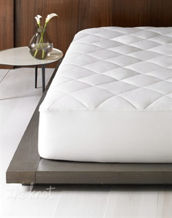 Sleep soundly in the quilted splendor of a luxurious cotton mattress pad from Hotel Collection.