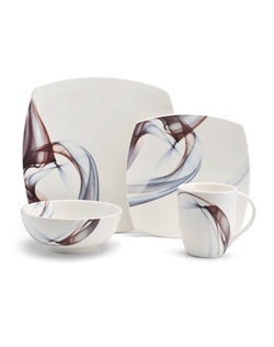 Kya introduces a pop of color to your tabletop. High-quality porcelain dinnerware is presented in a sophisticated, modern style with soft square shapes and a pattern of blue and purple shades on a clean white background.