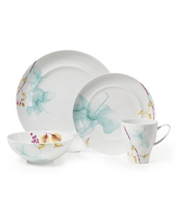 Mikasa Aliza Teal features a teal watercolor floral design, on a coupe-shaped rim, in a modern, asymmetrical layout, adding a pop of color to your table. This set will create a sophisticated yet contemporary look and is perfect for casual or formal dining. Crafted from high-quality European porcelain. Microwave and dishwasher safe.