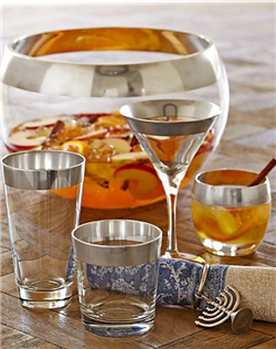 Our Silver Banded Glassware Collection is inspired by the bold sophistication of 1960s Madison Avenue glamour. Trimmed with 80% silver, this punch bowl creates an opulent showcase for fruit, salad and, of course, your special holiday punch. Each piece is hand blown and warm polished for a brilliant finish.