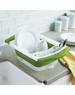 Leave your dishes high and dry with this Food Network dish rack. Collapses for easy storage. Extendable handles fit over the sink. Built-in drain board keeps counter dry.