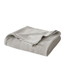 """100% organic cotton makes the Threshold Organic Blanket a cozy delight. These lightweight throw blankets work as regular bedding or tossed over a couch and used on chilly nights when curled up with a movie. This blanket is made with durability and longevity in mind, it will always keep its feel without pilling or wearing unevenly. The double needle stitching serves as reinforcement to insure these cotton blankets maintain their integrity. In addition to the organic quality sewn into every piece, these blankets come in a variety of cozy colors that make great additions to your home.   Number of Pieces: 1 Weave Type: Dobby Fabric Weight: Lightweight Fabric Construction Decorative Accents: Double Needle Stitching Fiber Content: 100 % Organic Cotton Dimensions: 12.0 """" L x 12.0 """" W  Care and Cleaning: Machine wash, cold, Non chlorine bleach when needed, Tumble dry, normal, low heat, Iron, low"""