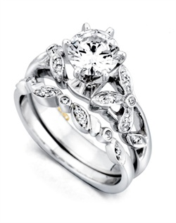 Shown with a 1ct center diamond. Sixteen diamonds totaling 0.085ct. Available in yellow, white, or rose gold, and platinum. Rings can be custom made to fit any size or shape diamond or color center stone. Center stone sold separately. Shown with matching wedding band. Wedding band contains 9 diamonds totaling 0.045ct. Wedding band sold separately.
