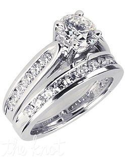 18k white gold-palladium alloy fluted channel engagement ring with total 1.00-CT round center diamond and total 0.30-CT TW round channel set side diamonds. Also available in 14k yellow gold, 14k white gold, and platinum.
