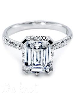 Platinum and diamond Solitaire Engagement Ring,  pictured with an emerald-cut center stone and pave-set diamonds on the shoulders of the band. This setting is also available with a smooth high-polish finish on the band.