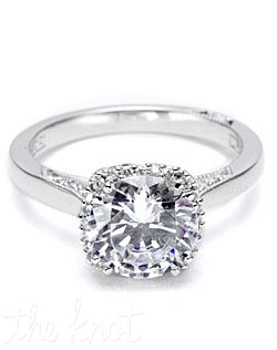 A beautiful juxtaposition of modern, yet traditional; classic, yet unconventional. This ring features a round center stone with diamond enhancers blooming the stone.  This setting is also available in Petite proportions; without pave shoulders; as a three-stone ring; or with Oval, Emerald or Princess centers.