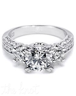 Platinum and diamond eternity Engagement Ring from the Crescent Silhouette collection, pictured with a round center stone, round side stones, round channel-set diamonds around the eternity band and round pave-set diamond details adorning the crescent silhouettes.  This setting is also available as a Solitaire (HT2326SOL), in Petite proportions, and with diamonds going all the way around the band.
