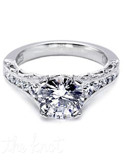 This elegant platinum and diamond eternity Engagement Ring is pictured with a round center stone and round channel set diamonds arching along the graceful profile.  Pave-set diamonds accent the reverse crescent silhouette details.